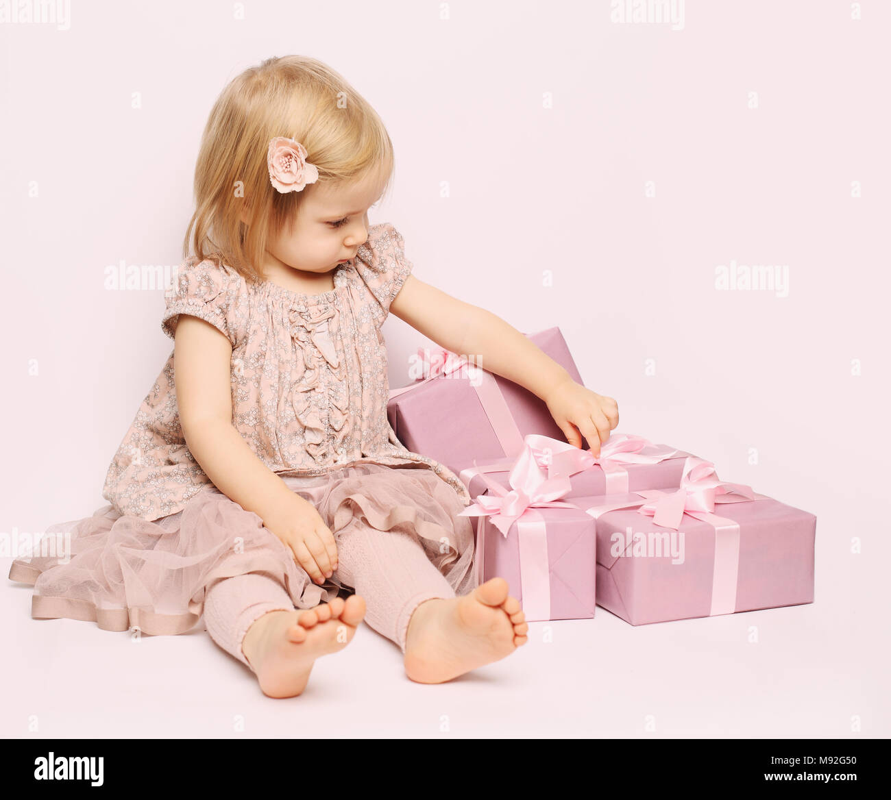 Little Child Girl With Pink Gift Box Birthday Background Stock Photo