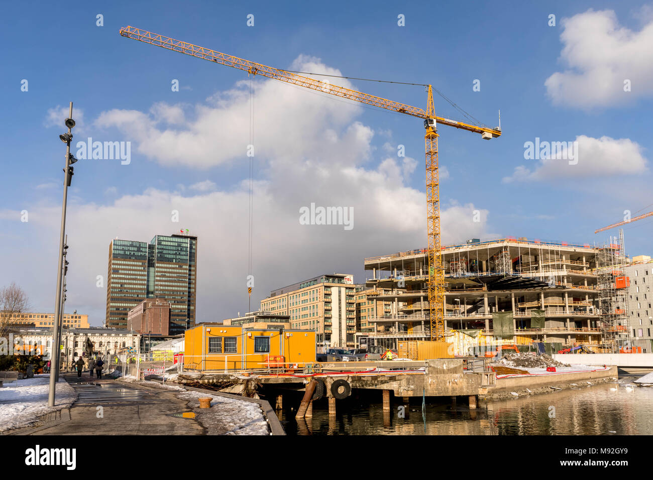 OSLO, Norway, March 2018: Building site with cranes and containers in Bjorvika in Oslo, next to the Opera House. - Stock Image