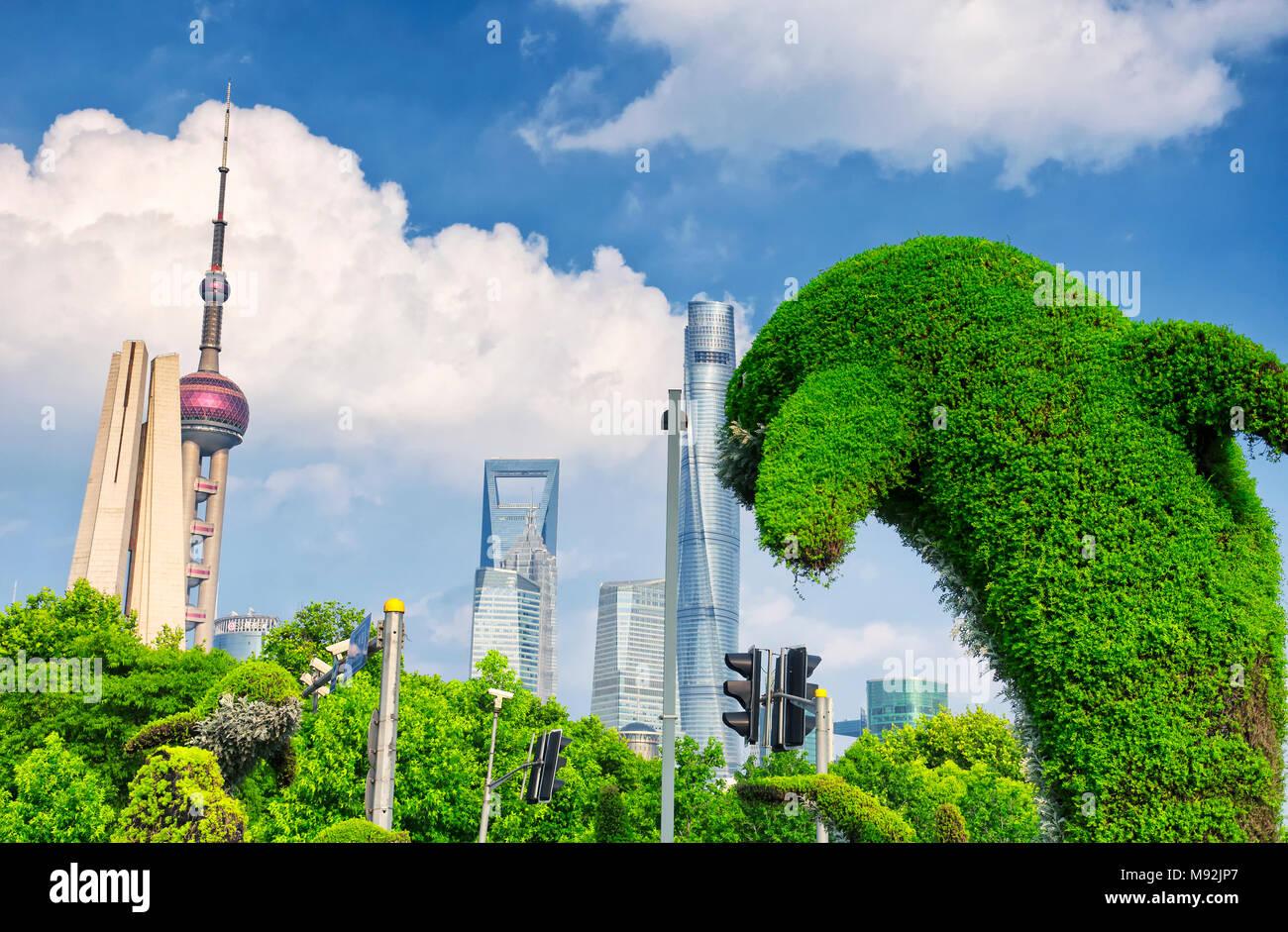 A large dolphin shaped bush near the waibaidu (garden) bridge on the Puxi side of Shanghai China. - Stock Image
