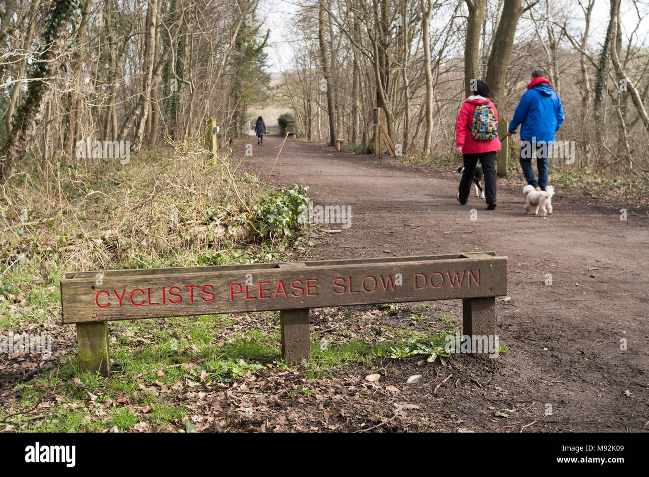 Sign Cyclists Please Slow Down on the Derwent Walk ex railway path, north east England, UK Stock Photo
