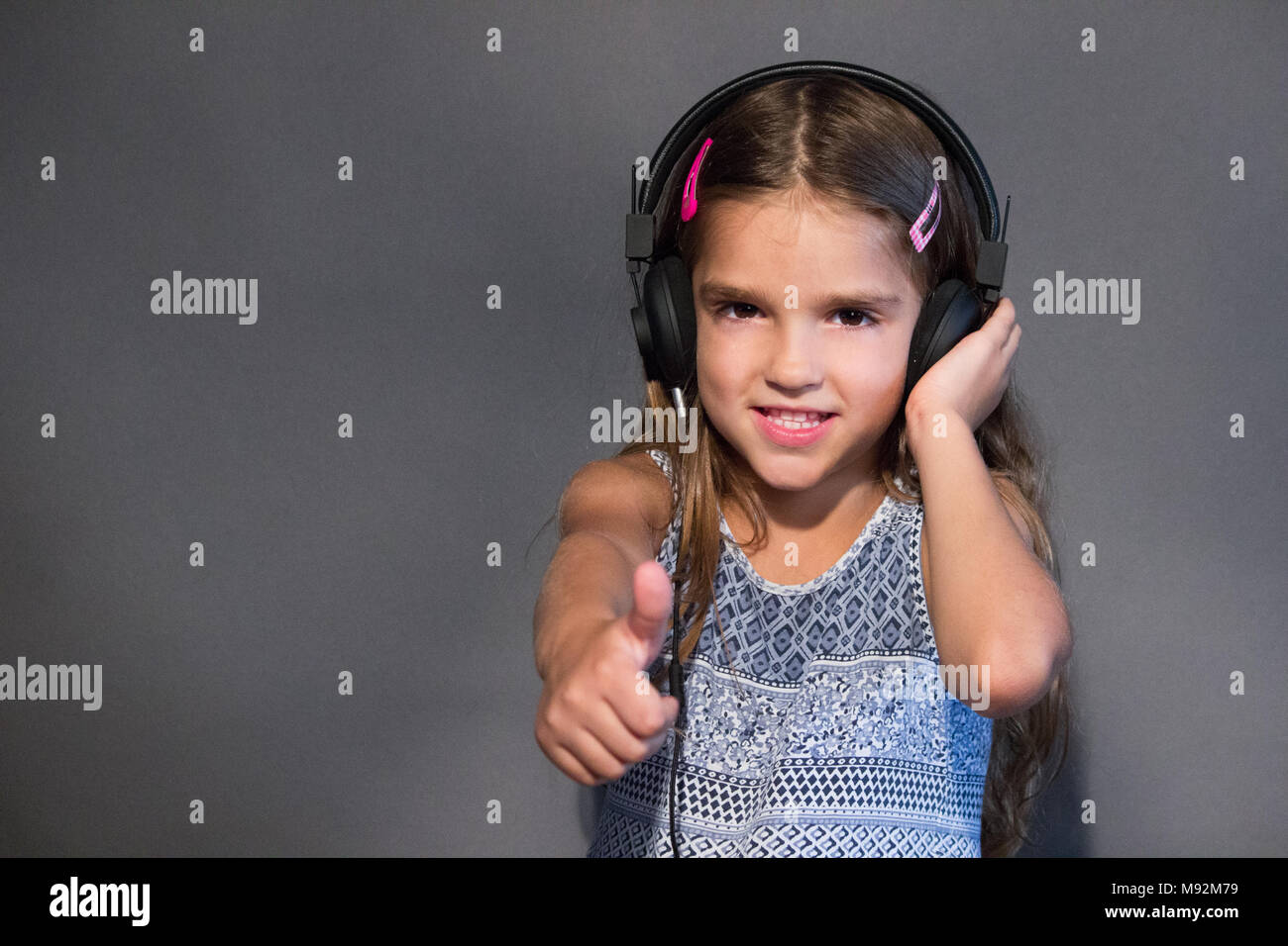 girl music agree thumb up Stock Photo