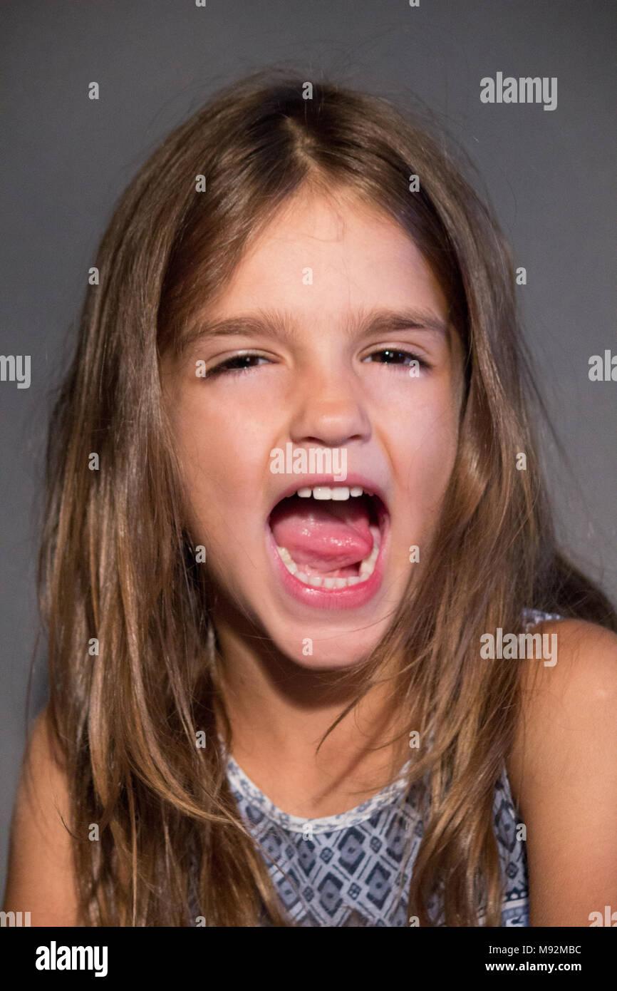 studio portrait girl screaming - Stock Image
