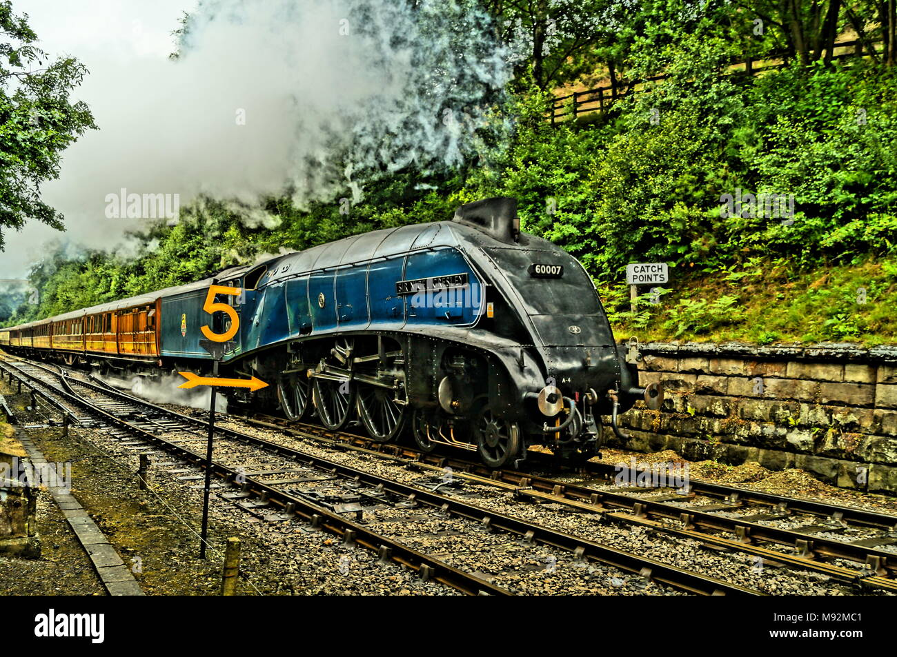 Post War Steam train world speed record holder Sir Nigel Gresley Steam train heading to Goathland Station - Stock Image