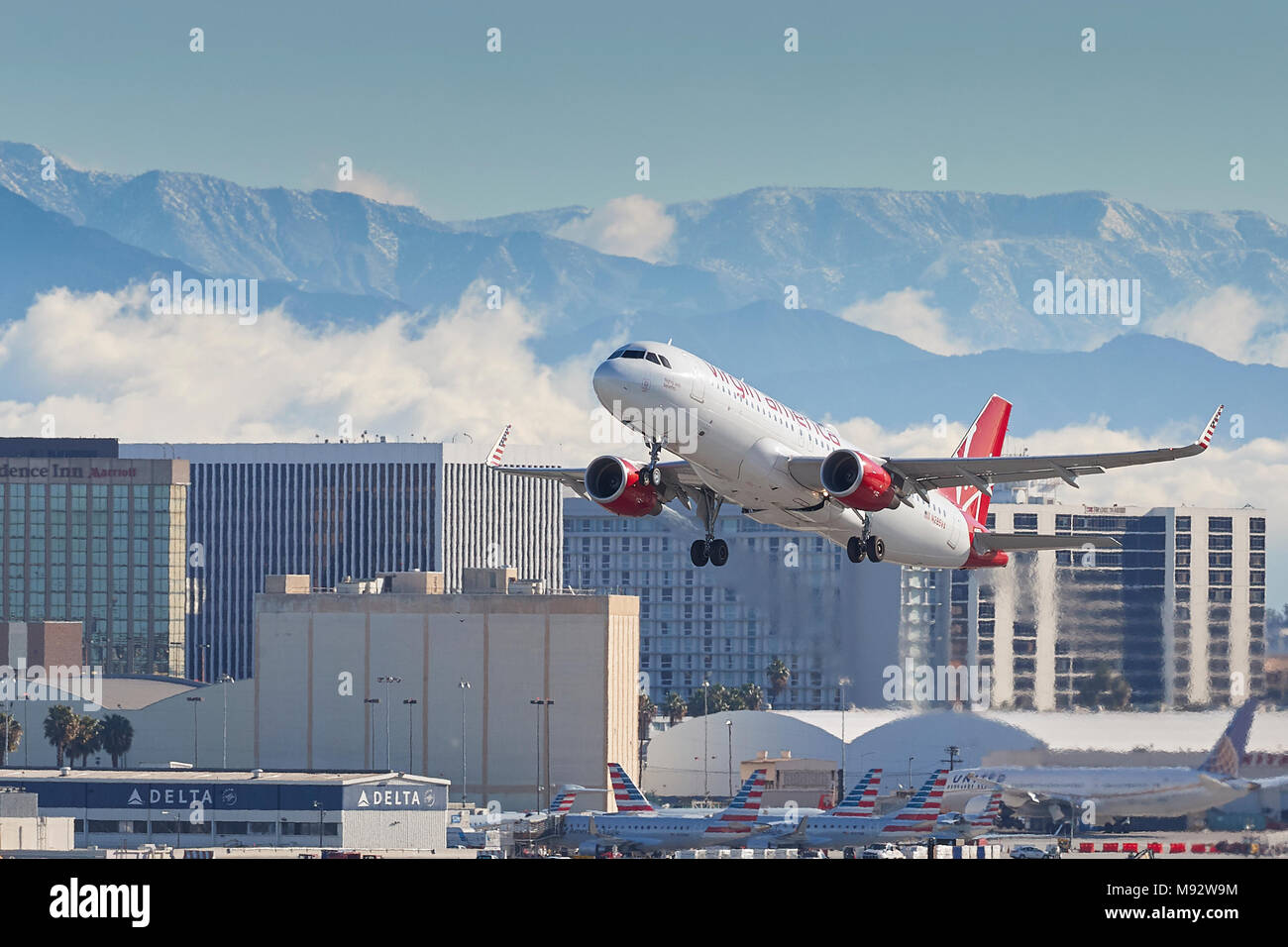 Virgin America Airbus A320 Jet Plane, Taking Off From Los Angeles International Airport, LAX, The Snow Covered San Gabriel Mountains Behind. USA. - Stock Image