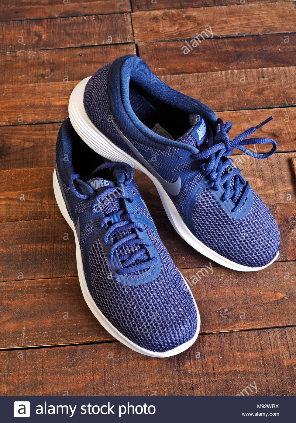 blue lace-up Nike trainers