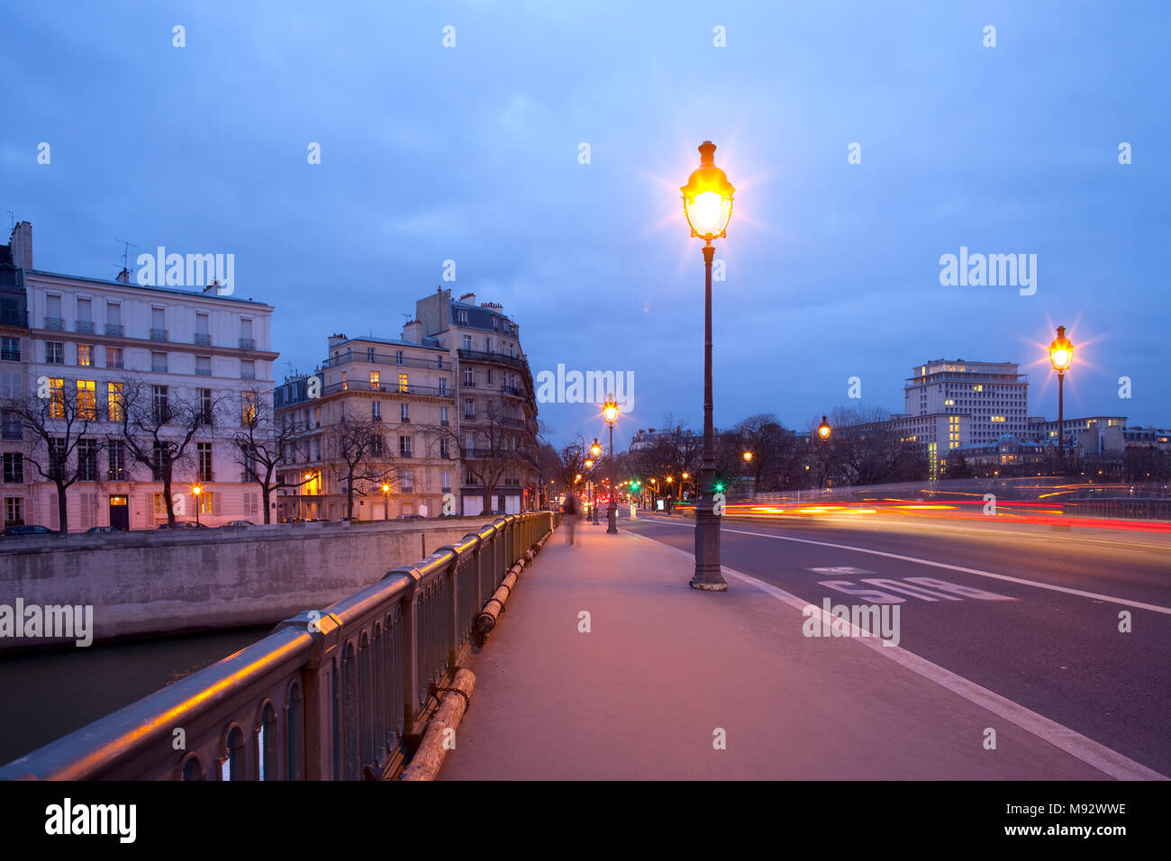 Pont de Sully bridge over Seine River, Ile Saint Louis, Paris, France - Stock Image
