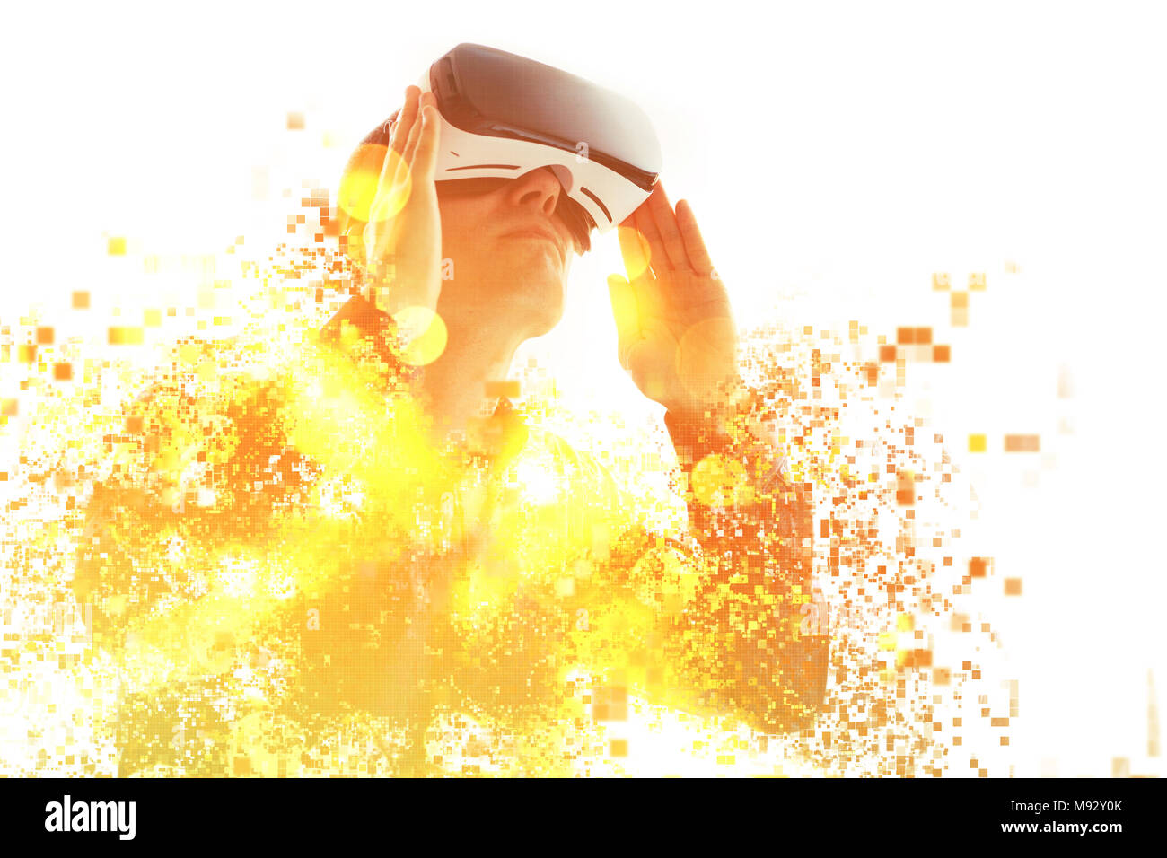A person in virtual glasses flies to pixels. The man with glasses of virtual reality. Future technology concept. Modern imaging technology. Fragmented - Stock Image