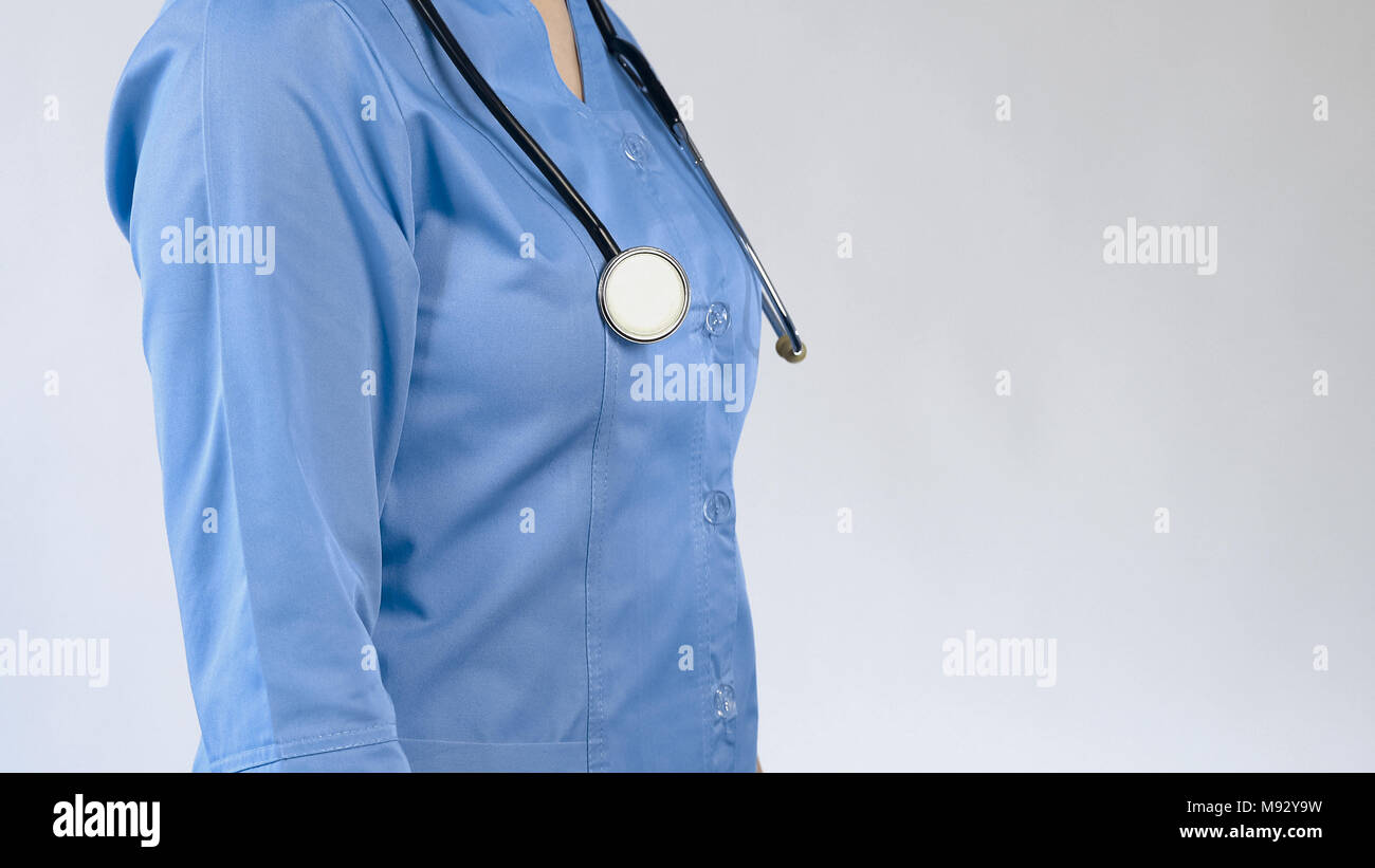 Female doctor with stethoscope, hospital worker, patient consultation, diagnosis - Stock Image