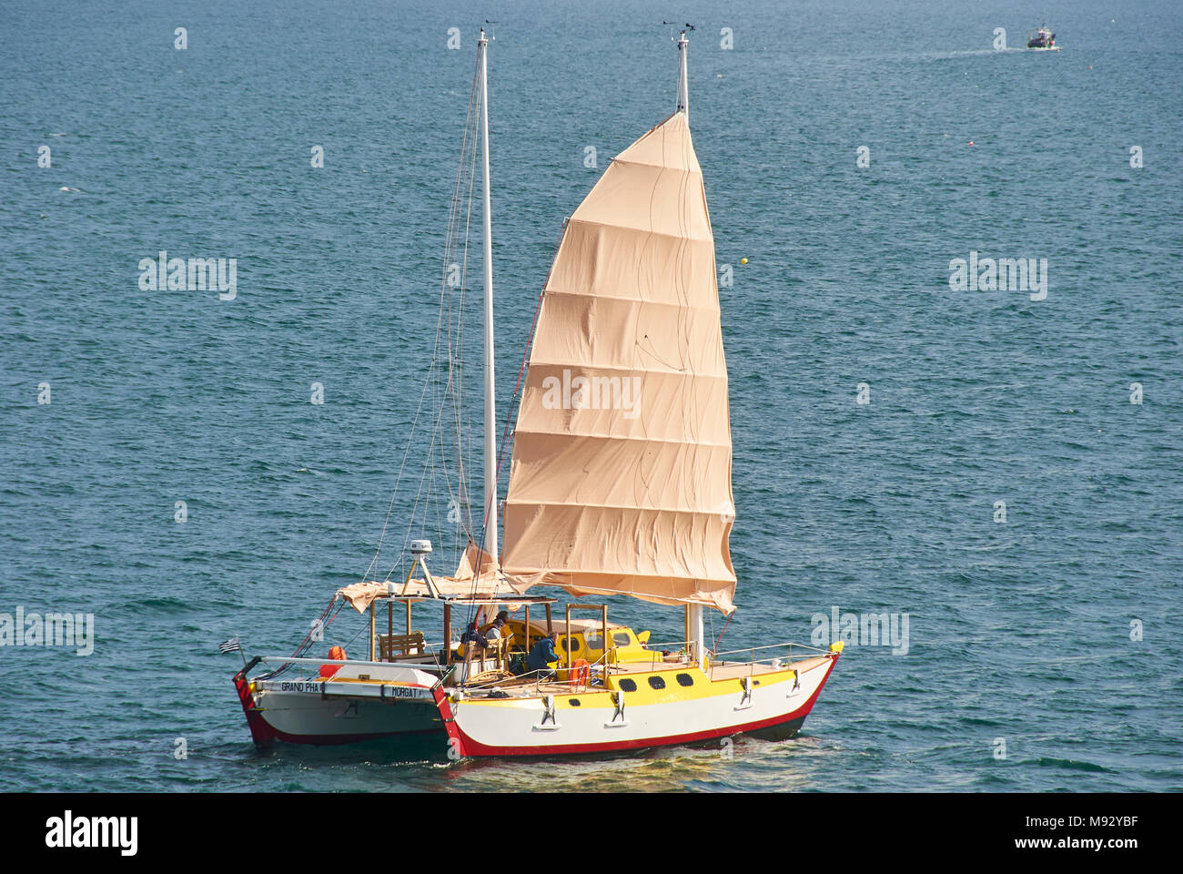 The Grand Pha, a French built Catamaran with a soft sail Rig starts its voyage off the Rade de Brest for the Mediterranean. Stock Photo