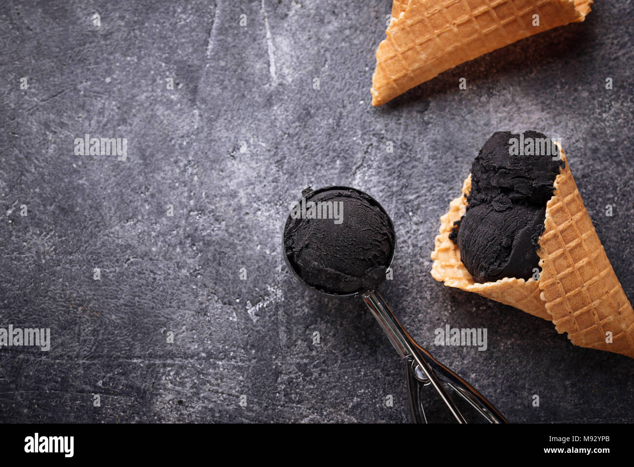 Black ice cream. Trendy food - Stock Image