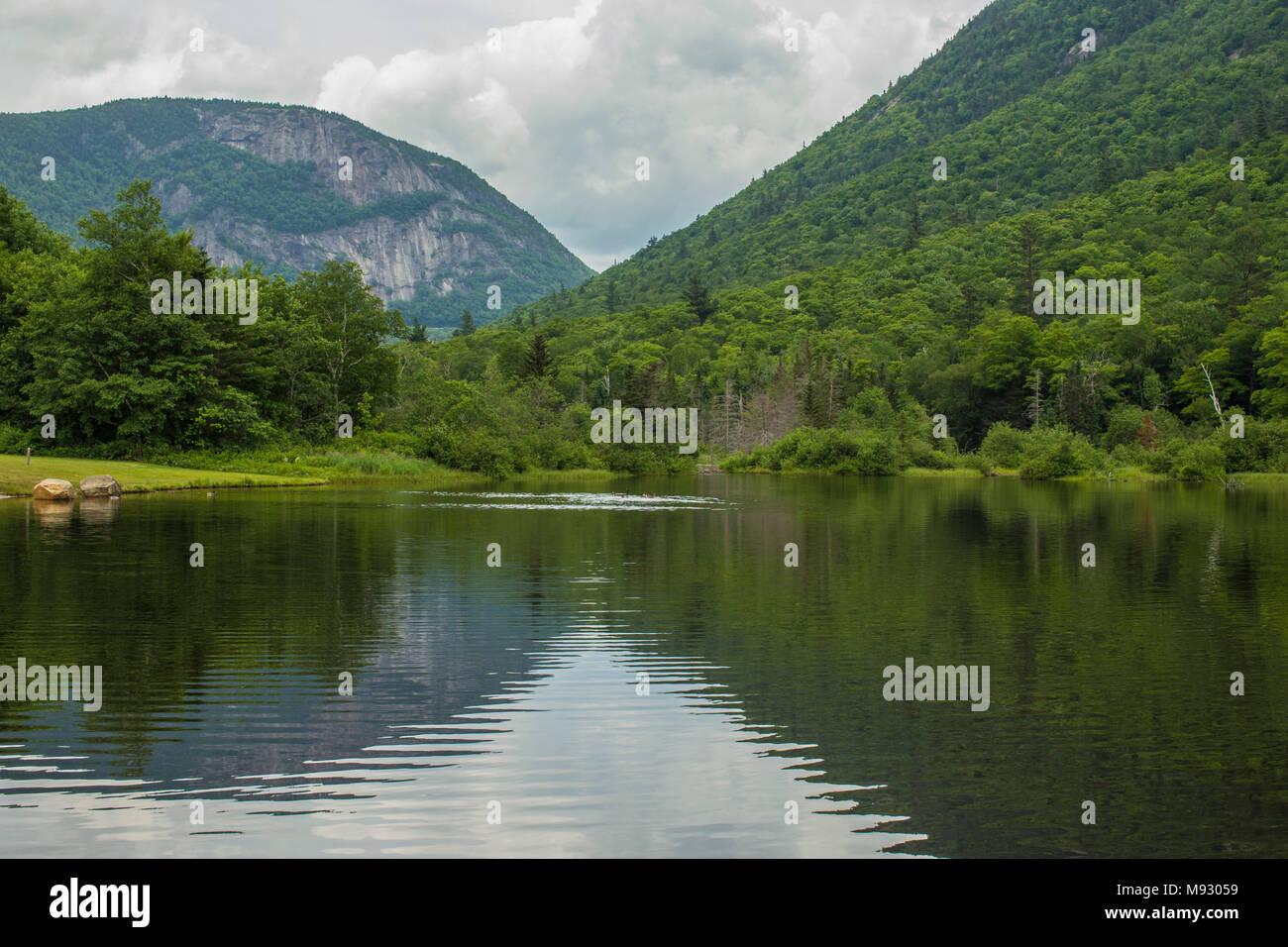 V Pattern of White Mtns on Wiley Pond. Hart's Location, NH, Roads, Willey Pond, Mountain Notch, Tourism, Shorelines, V Shape, Rock slide, W.M. Notch Stock Photo