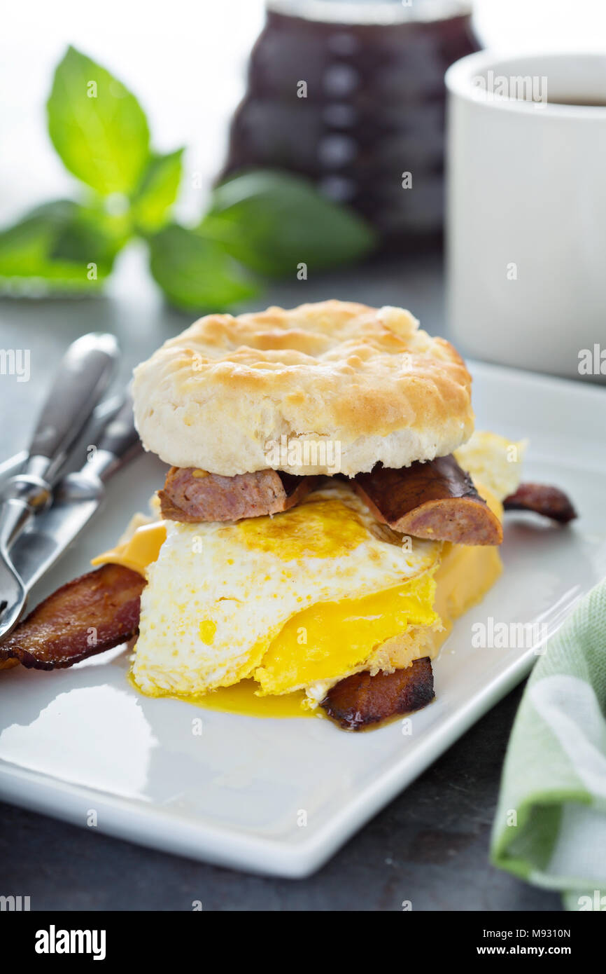 Biscuit breakfast sandwich with bacon, egg and sausage Stock Photo