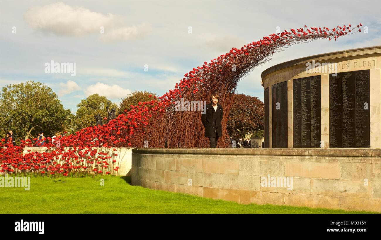 Poppy Waterfall installation at Plymouth, England.  UK tour of poppies to commemorate the dead and missing servicemen and women of World Wars - Stock Image