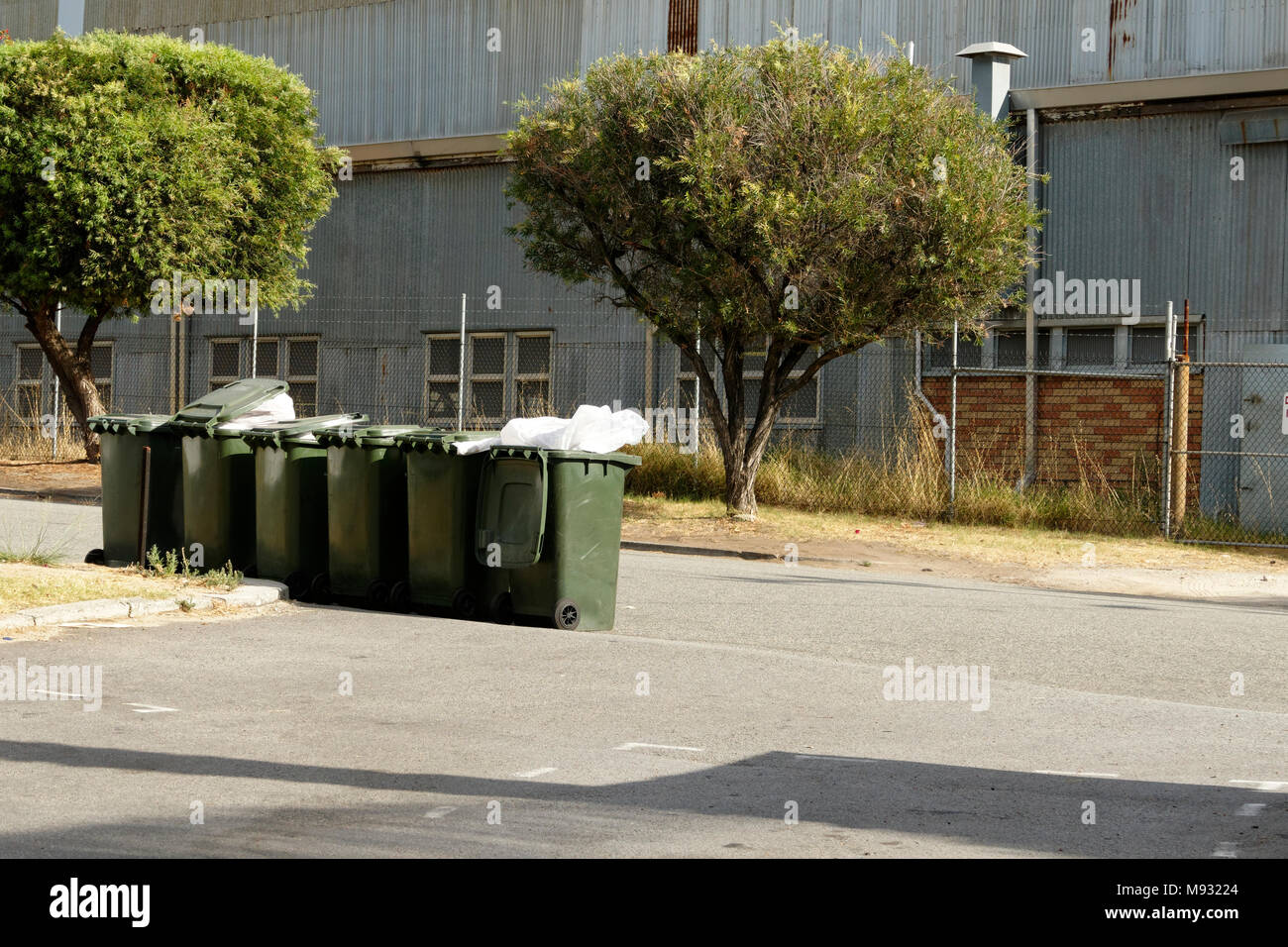 Wheelie rubbish bins on side of road, Perth, Western Australia - Stock Image