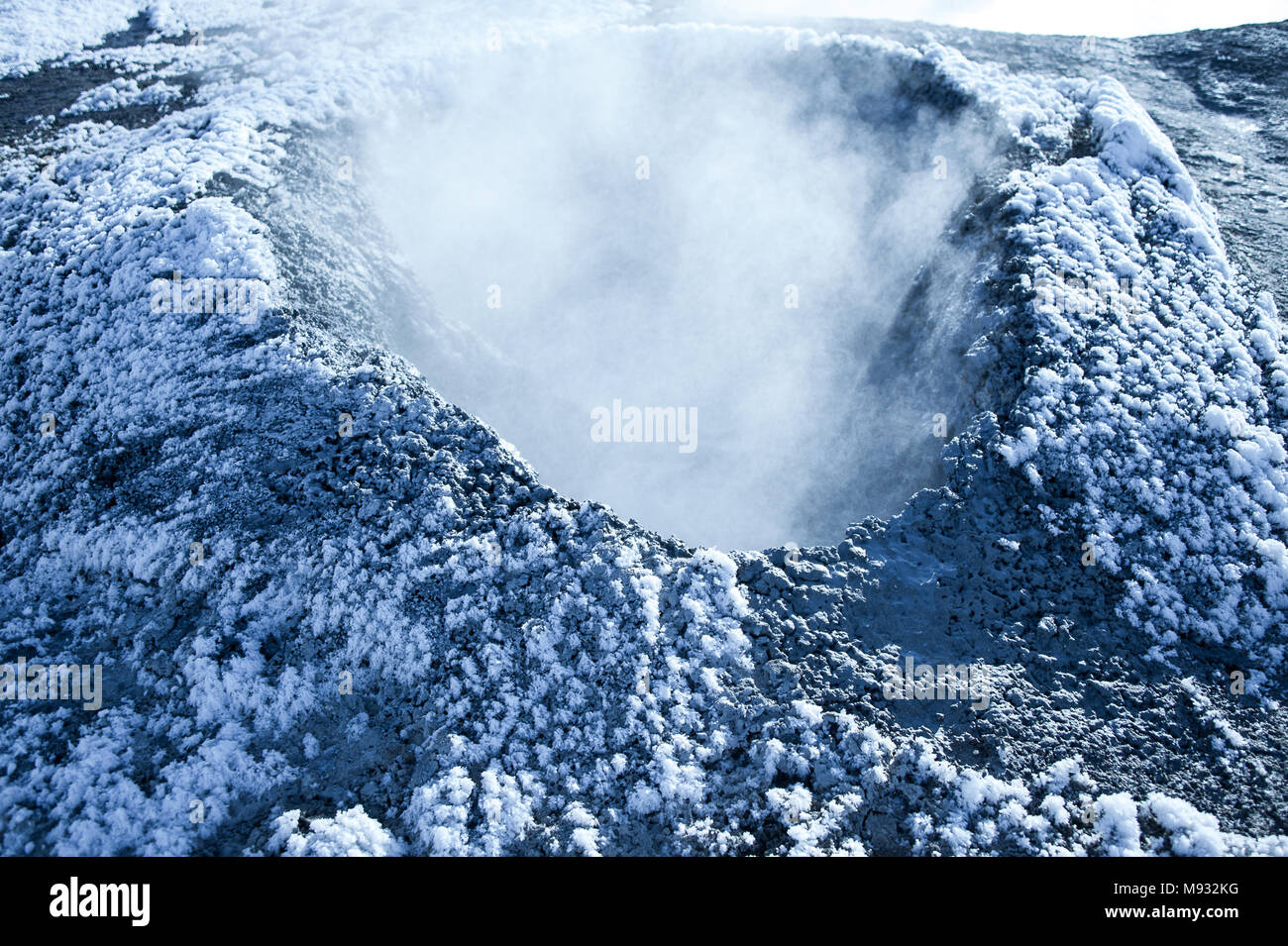 Steaming solfataras at Namafjall geothermal fields, Myvatn, Iceland. Close up of crater covered in ice crystals - Stock Image
