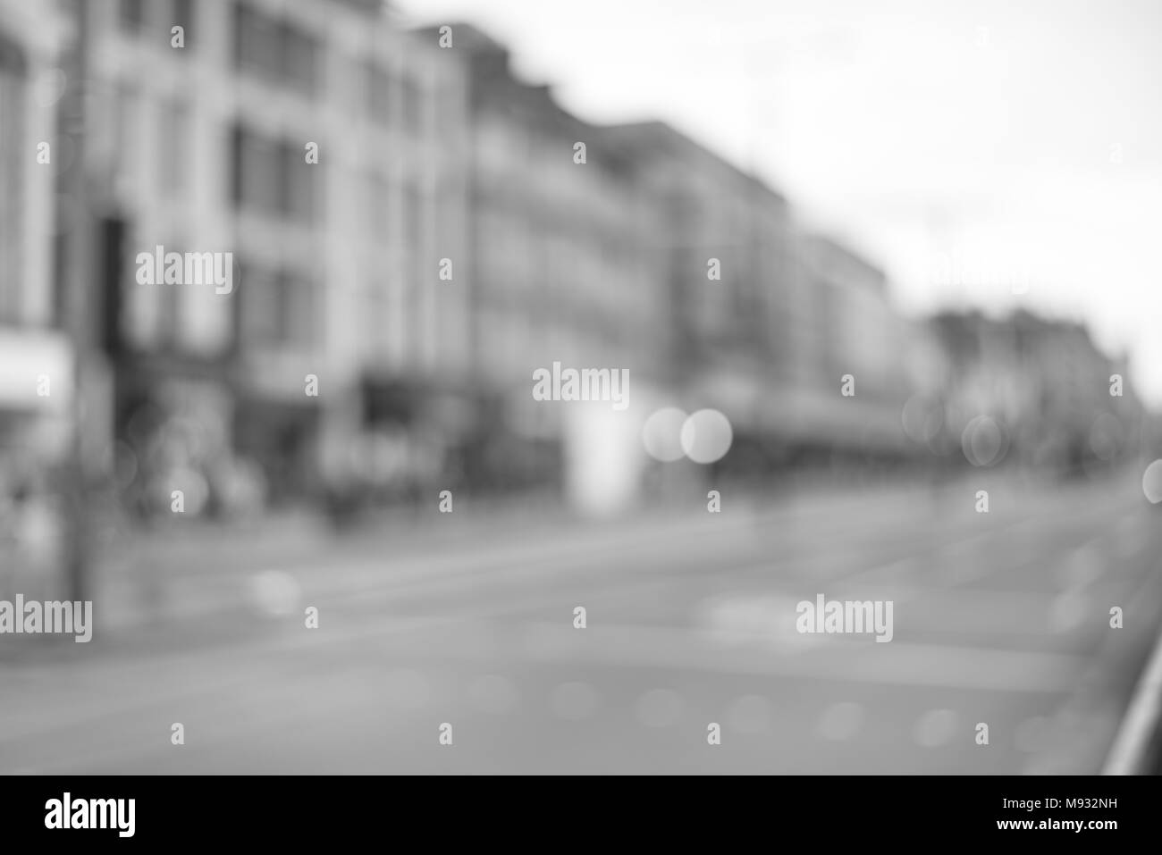 Blurred City Centre with Taxi and Passerby - Stock Image
