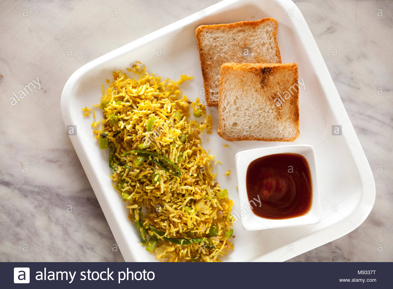 Tofu scramble is a popular snack and quick breakfast with tofu. This is a vegan and vegetarian snack. - Stock Image