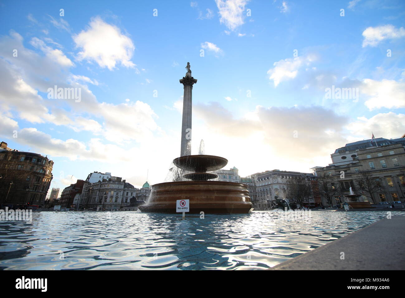 A fountain in Trafalgar square, London, England - Stock Image