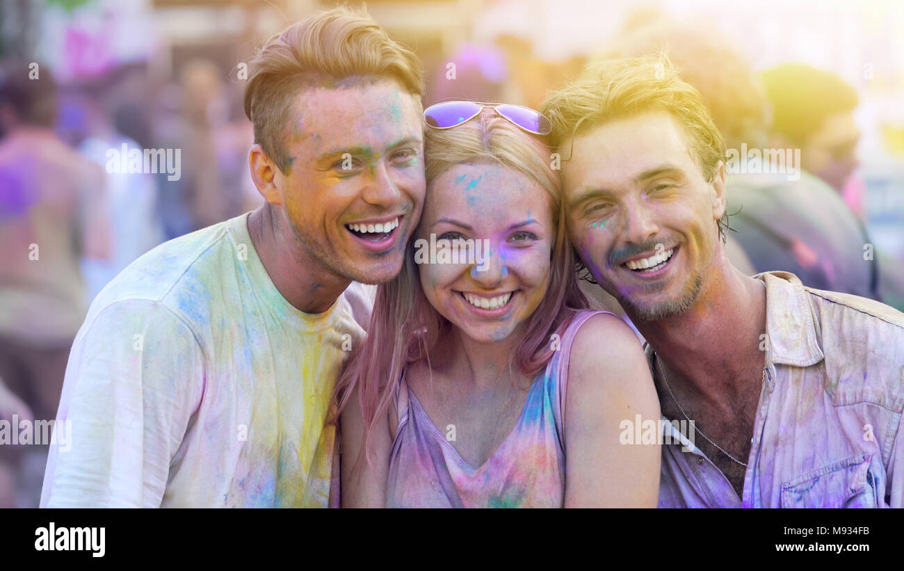 Young people enjoying summer festival, smiling friends having fun outside, party - Stock Image