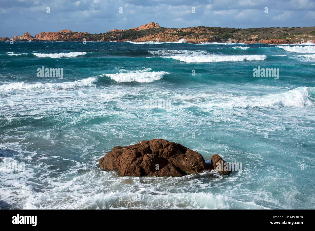 a view of the Mediterranean sea, with a strong swell, in La Marinedda beach, in Isola Rossa, Sardinia, Italy - Stock Image