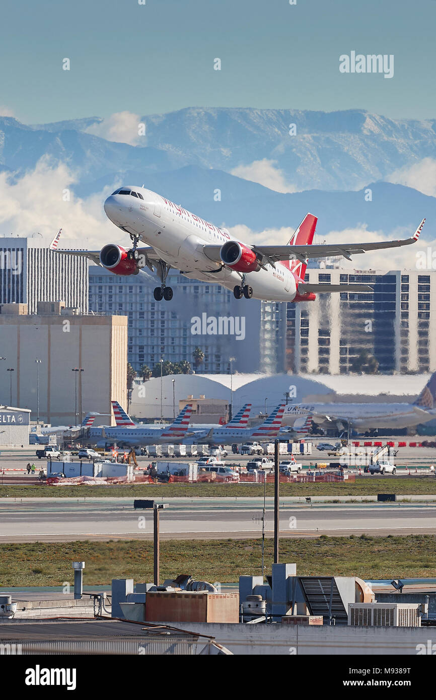 Virgin America Airbus A320 Jet Plane, Taking Off From Los Angeles International Airport, LAX, The Snow Covered San Gabriel Mountains Behind. - Stock Image