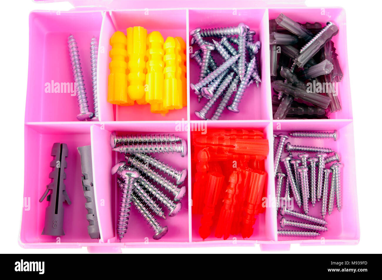 Pink box with screws and dowels isolated on white - Stock Image