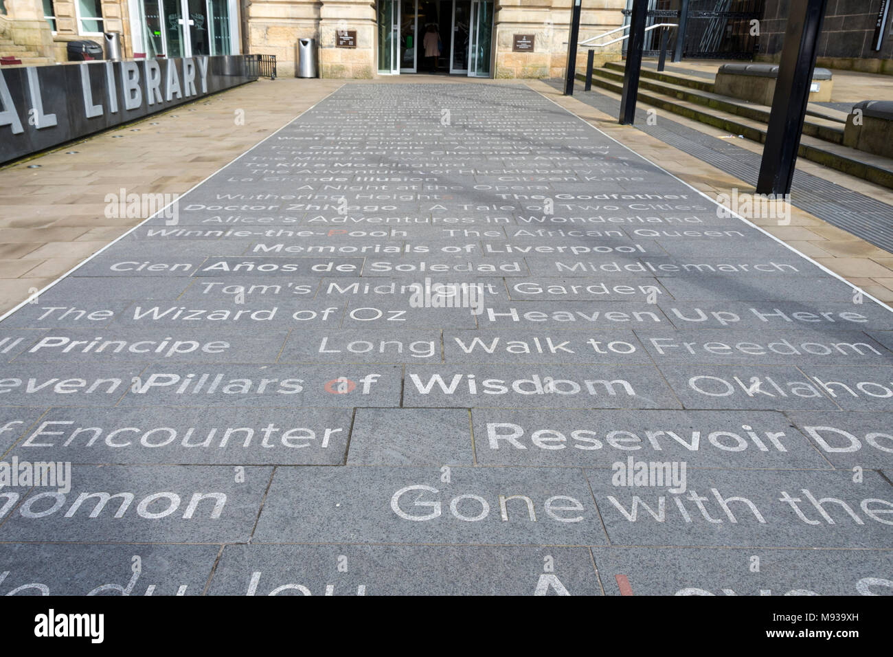 Book titles set into paving stones at the entrance of the Central Library.  St. George's Quarter, Liverpool, England, UK - Stock Image