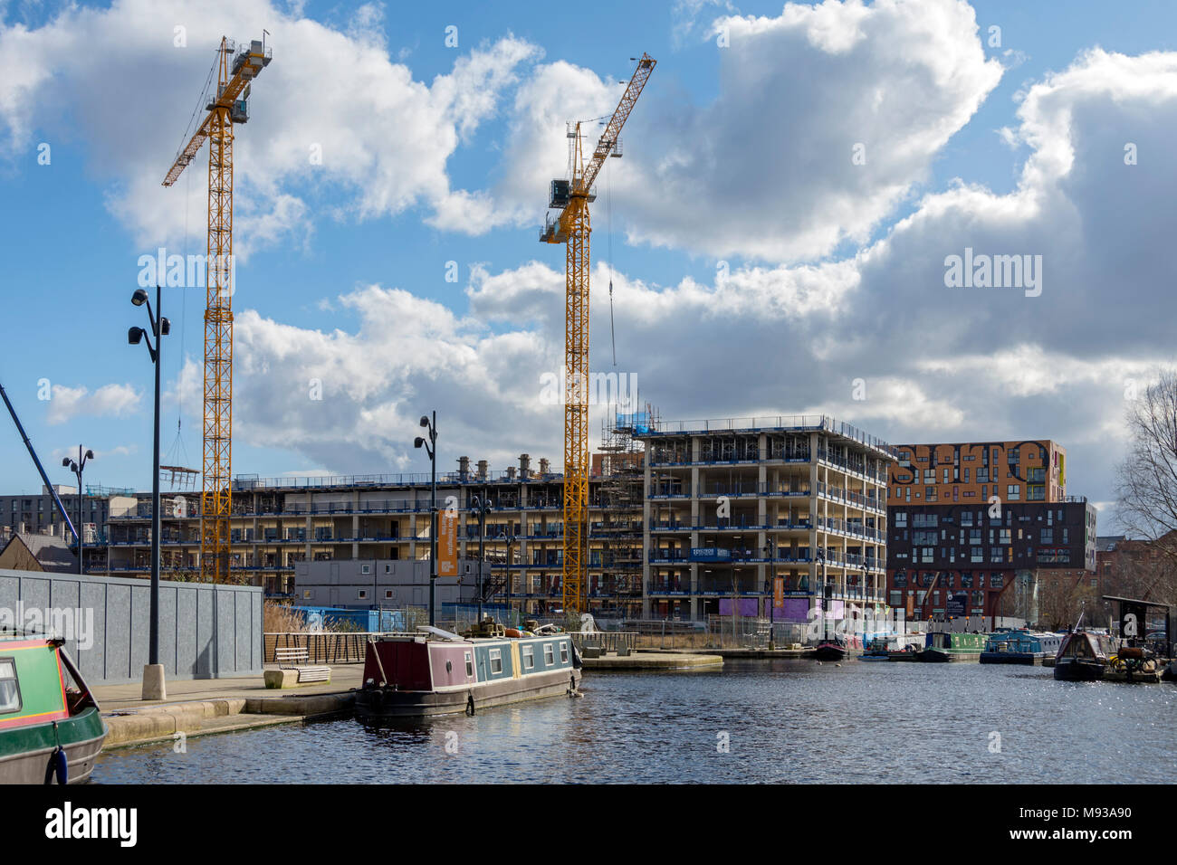 The Weavers Quay apartments blocks under construction, from Cotton Field Park, New Islington, Ancoats, Manchester, England, UK - Stock Image