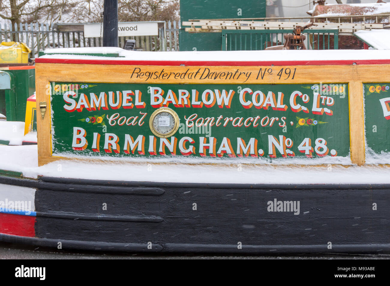 Signage on a narrowboat on the Ashton Canal at Ashton-under-Lyne, Tameside, Manchester, England, UK - Stock Image