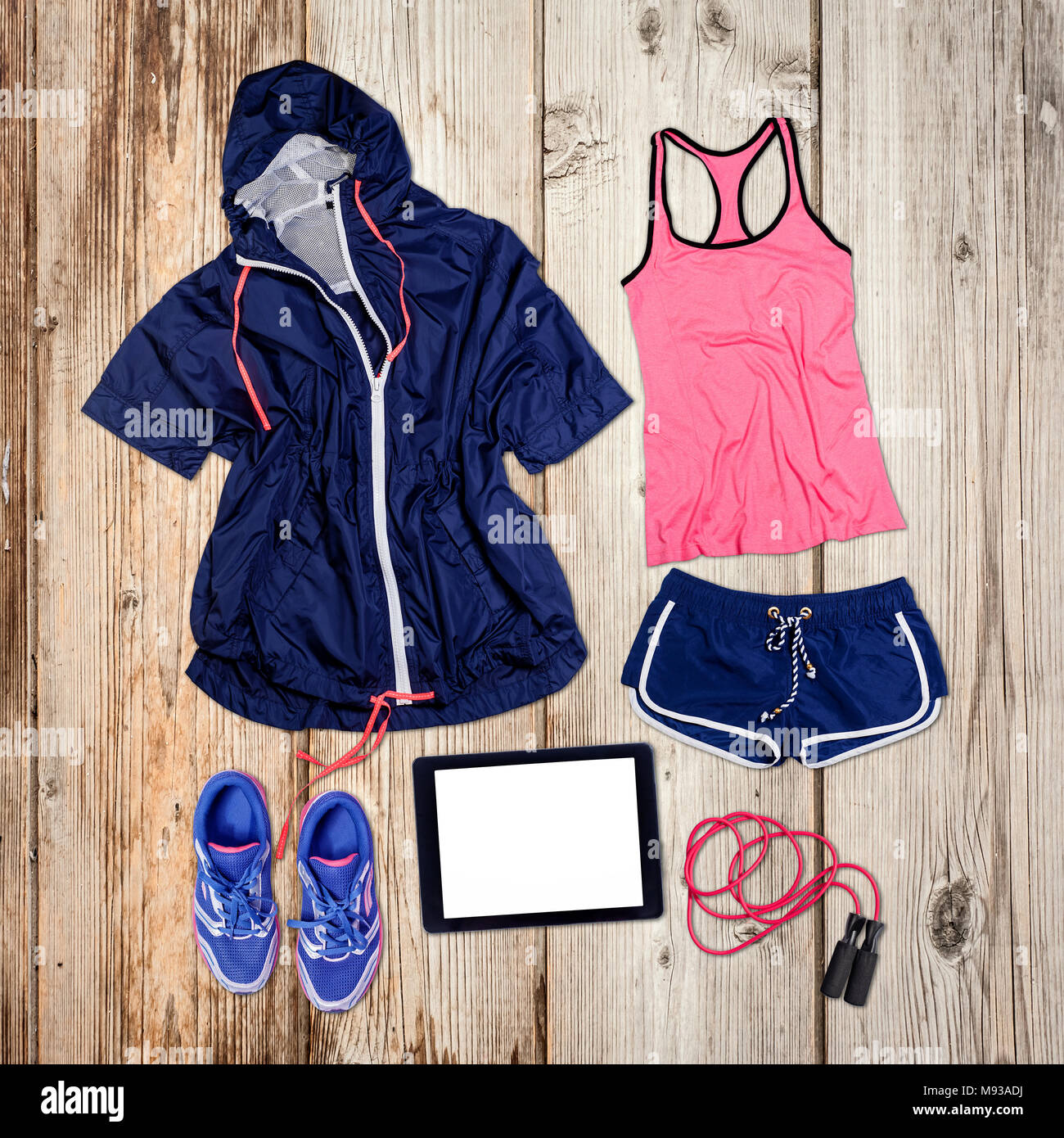 Sports outfit and equipment on wooden floor. - Stock Image