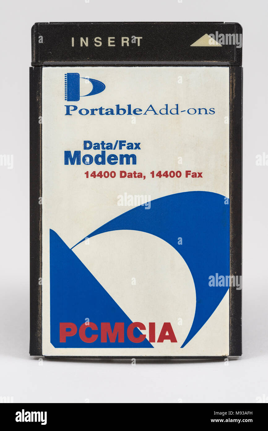 Fax modem PCMCIA plug-in card for a laptop computer. - Stock Image