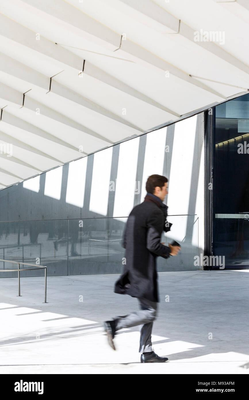 Ground level entrance to public square. Energia de Portugal Headquarters, Lisbon, Portugal. Architect: Aires Mateus, 2016. Stock Photo