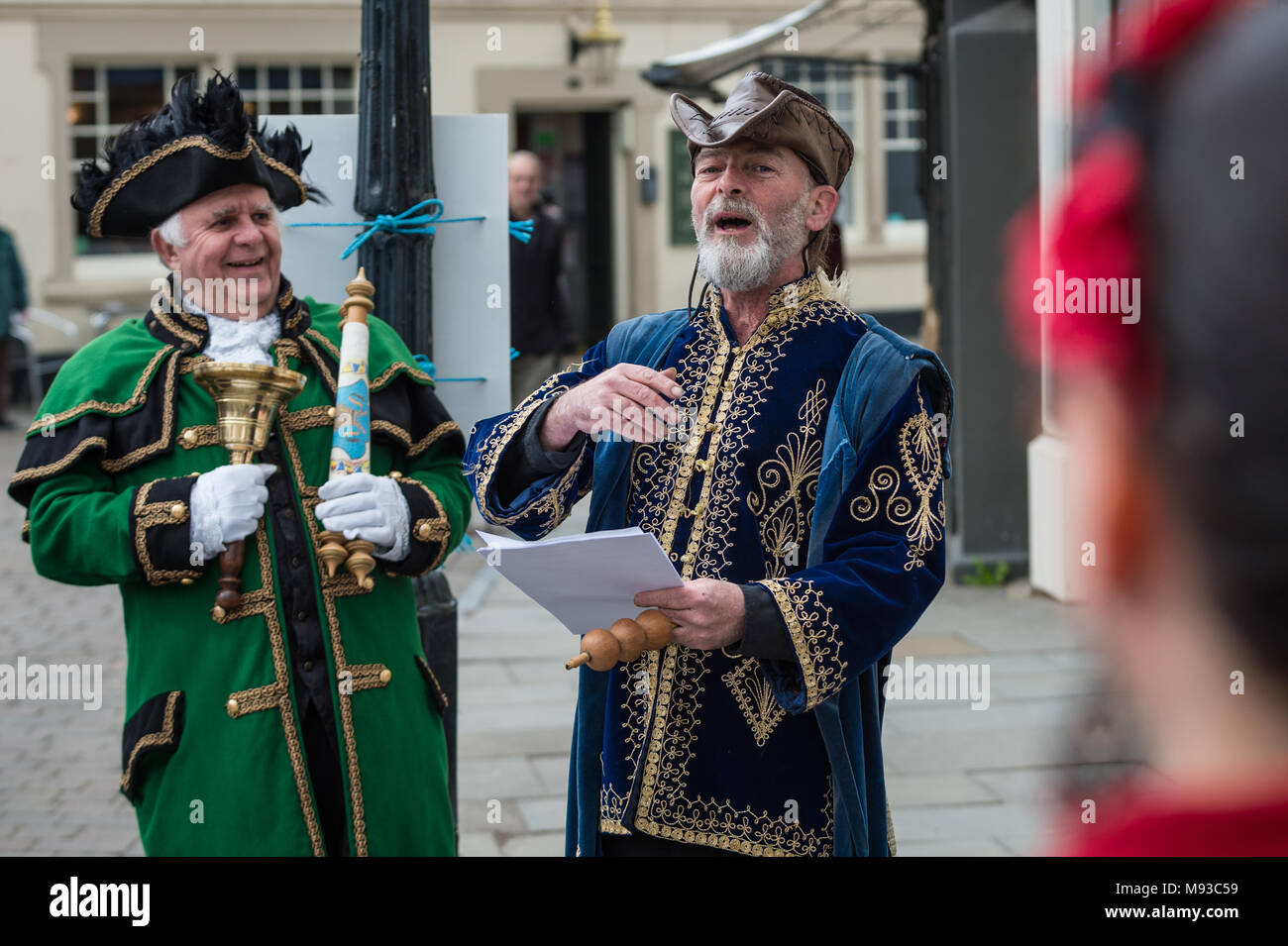 The Town Crier of Glastonbury (David Greenway) announces this year's competition to choose the next Bard of Glastonbury. - Stock Image