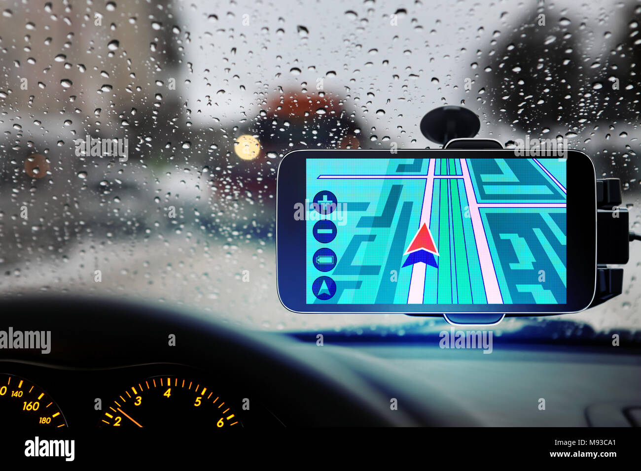 travel guide helps a driver to arrive in appointment point at rainy weather - Stock Image