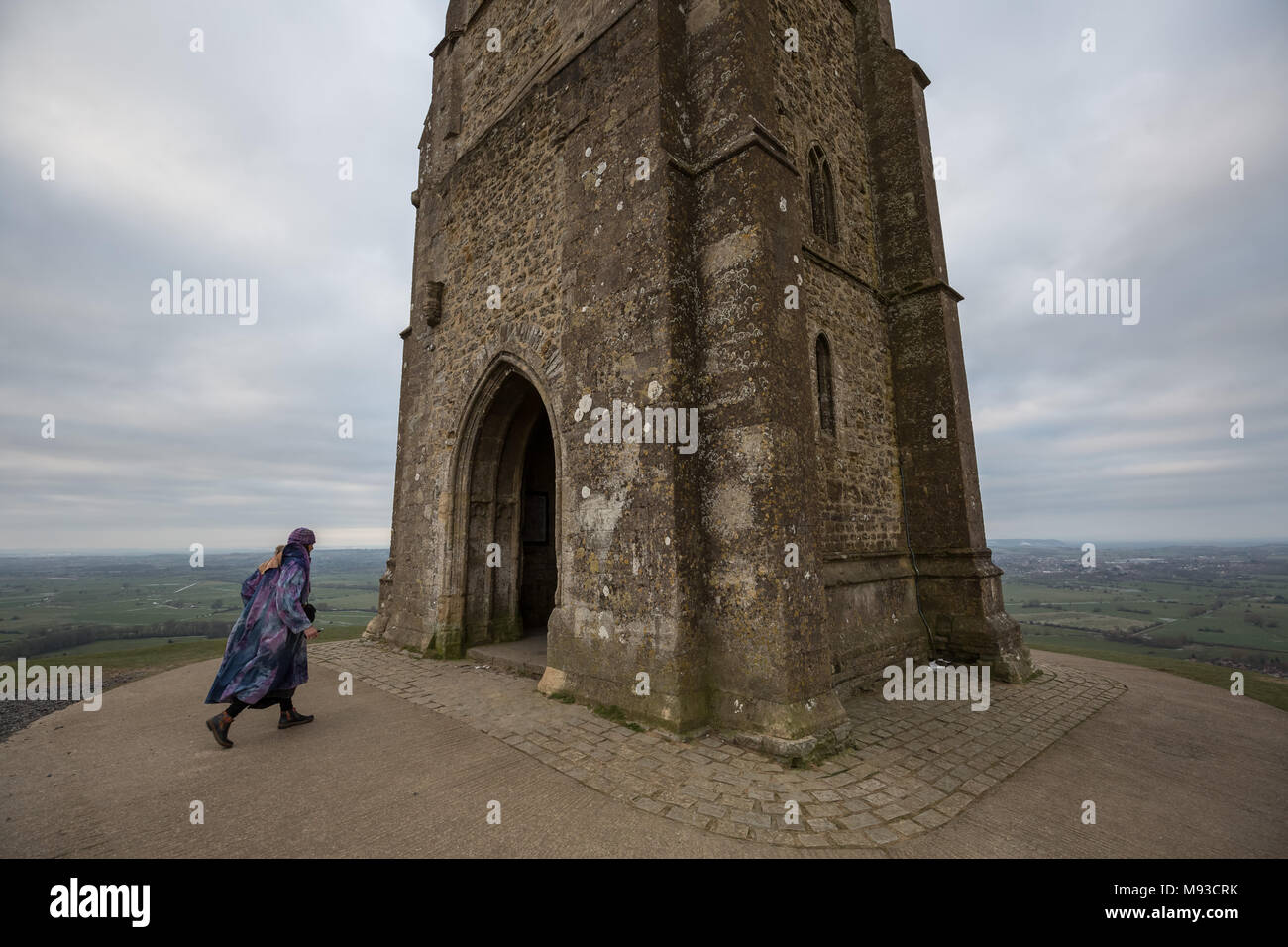 Glastonbury, UK. 20th March, 2018. Spring Equinox (or Vernal Equinox) is celebrated at dawn from the top of Glastonbury Tor. Locals and spiritualists - Stock Image