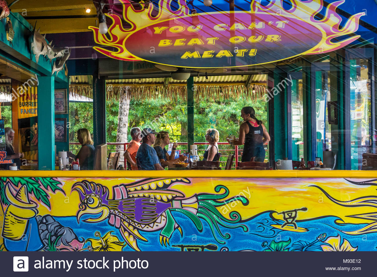 Mexican cafe restaurant double entendre mural travel on the island of Maui in the state of Hawaii USA - Stock Image