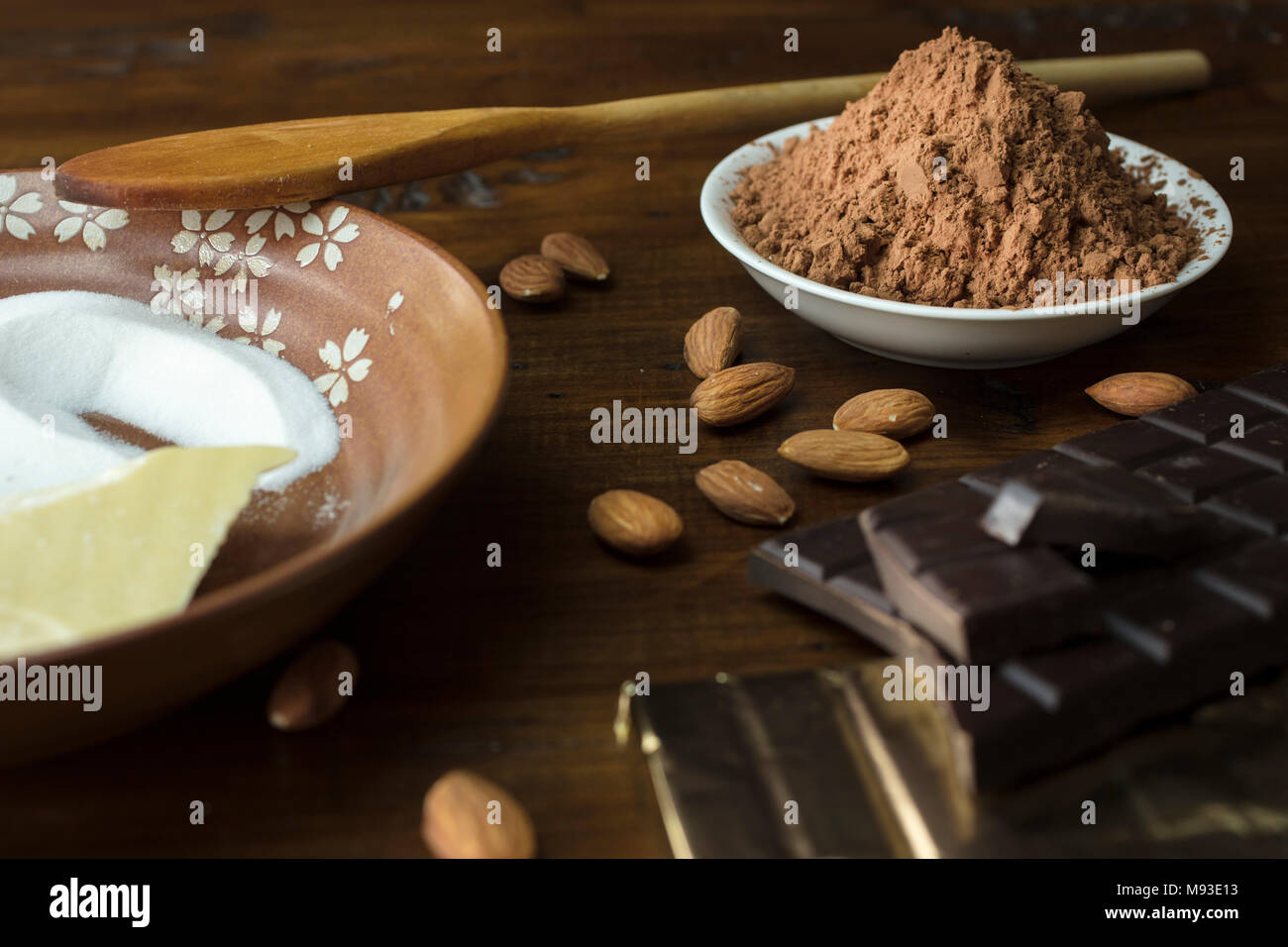 Preparation of dark chocolate bars made from scratch using cacao butter, sugar, cocoa powder and almonds Stock Photo