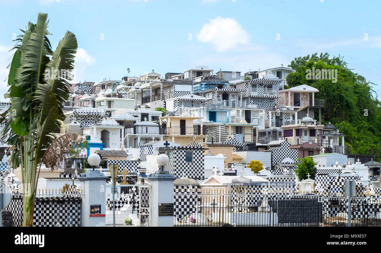 Cemetery of Morne-a-l'eau, Basse-Terre, Guadeloupe, with typical black and white graves all over the hill - Stock Image