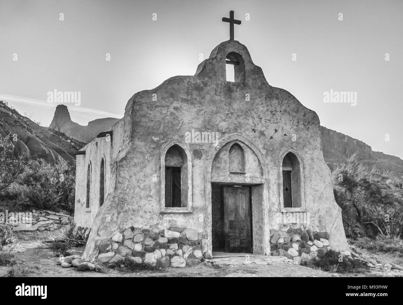 Adobe mission church built for movie set 'Streets of Laredo', on the Rio Grande River in Texas. - Stock Image