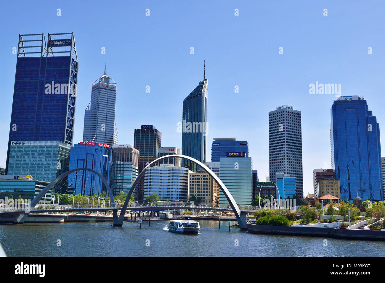 Elizabeth Quay Perth with business area behind and arcade of iconic Elizabeth Quay pedestrian bridge in the foreground - Stock Image