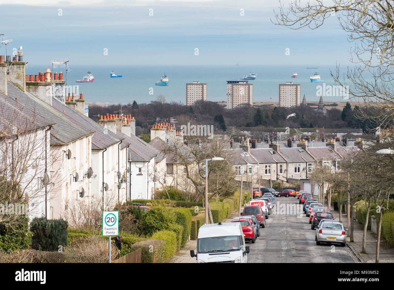 view of residential area of Aberdeen, north of the city centre - property housing types and Seaton Park, with waiting supply vessels at anchor - Stock Image
