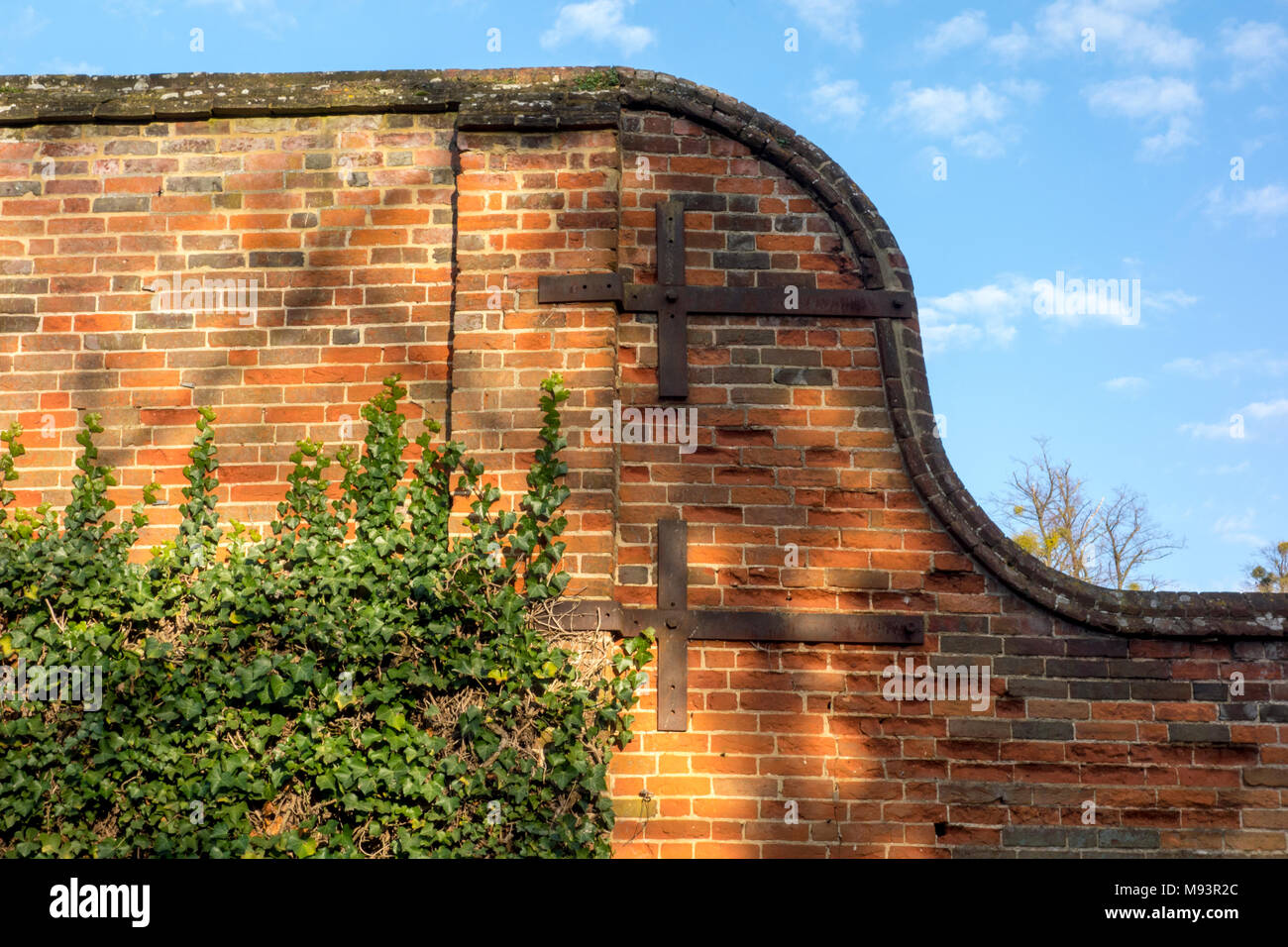 Old brick wall with metal retaining supports - Stock Image