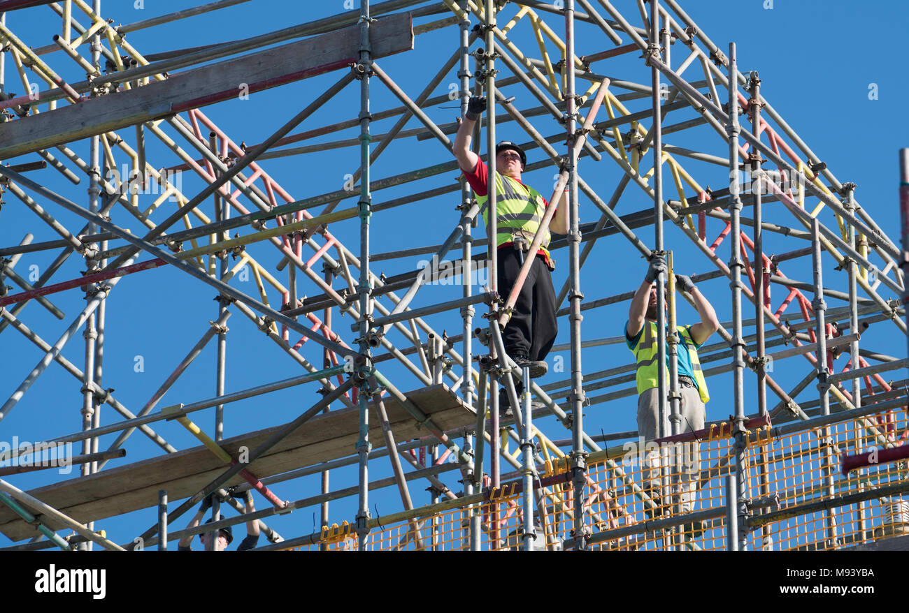 Scaffolders working on residential house under construction in East Lothian , Scotland, United Kingdom - Stock Image