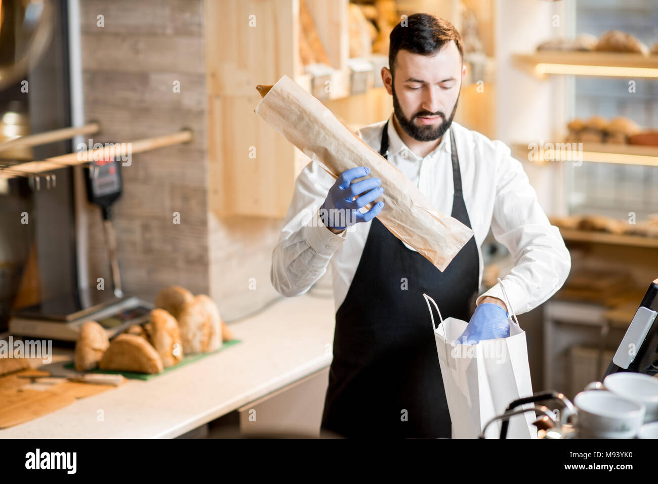Seller in the bread store - Stock Image