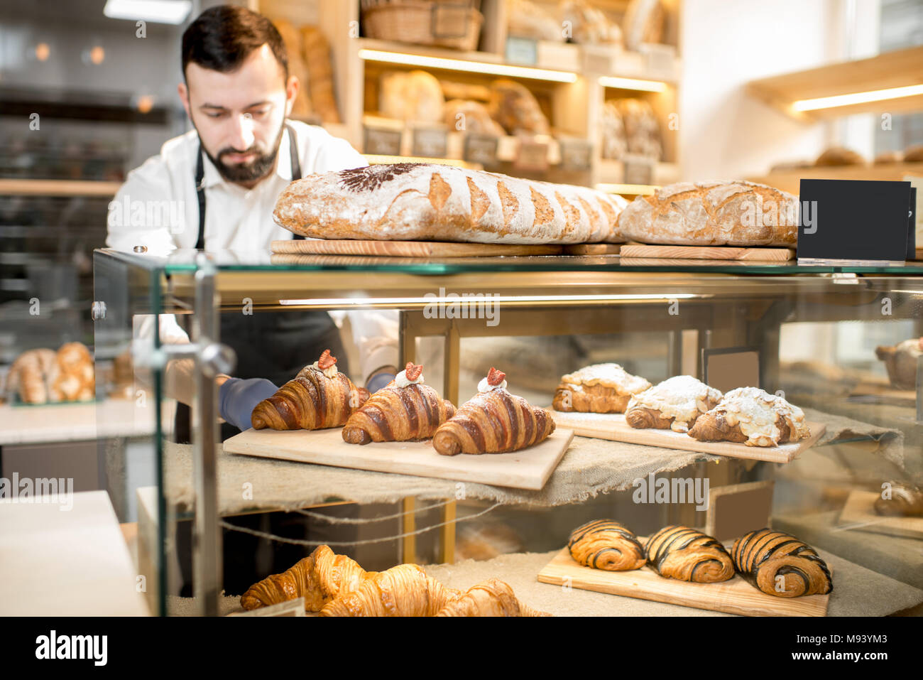 Croissant on the store showcase - Stock Image
