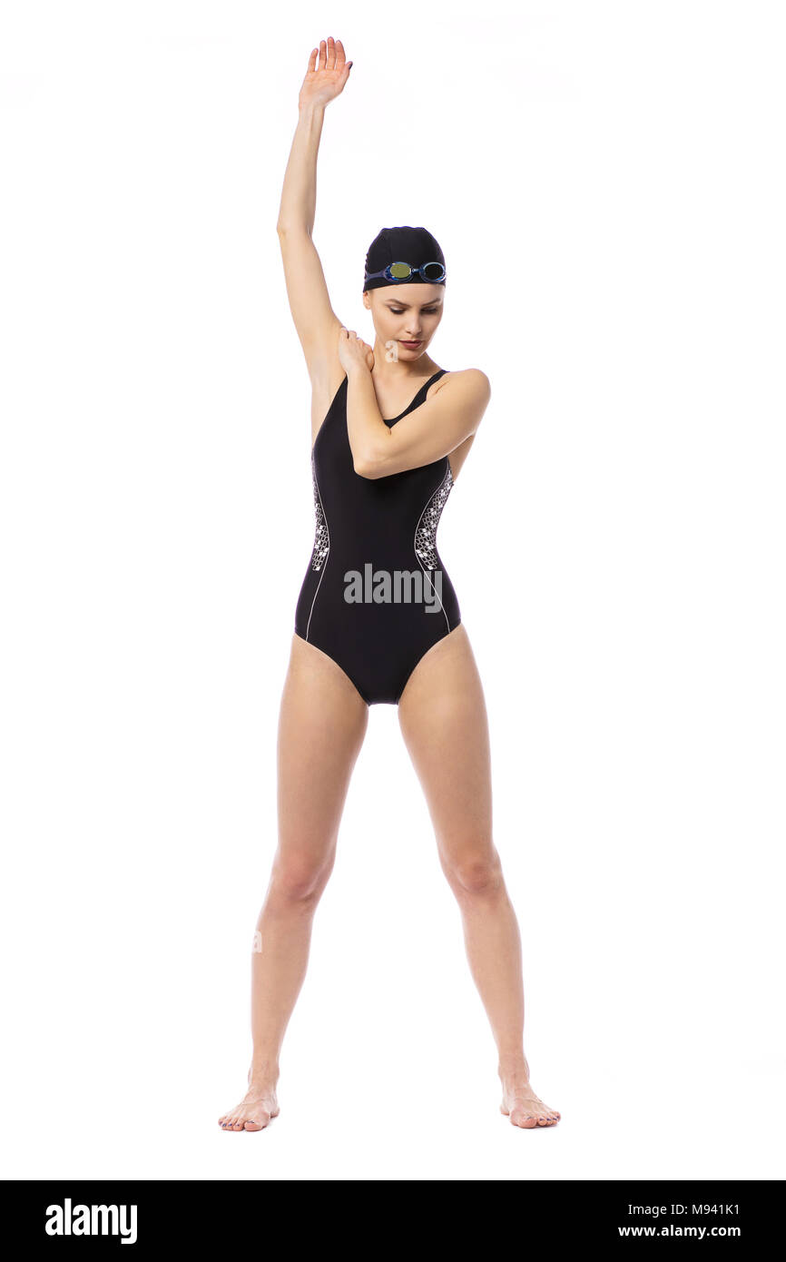8de358563c117 Swimmer women in swimming suit preaparing for swim, warming his shoulders,  elbows, back