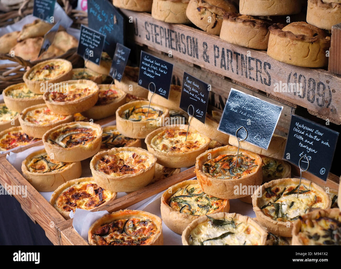 Quiches made by Snowdrop Cottage, on sale at farmers market at Whiteladies Road, Bristol, UK - Stock Image