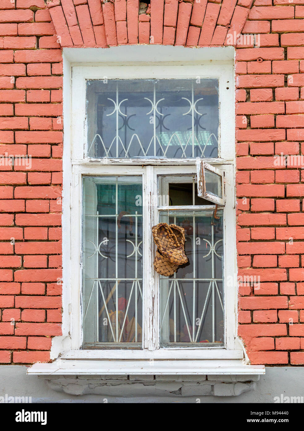 The bast shoes hang on the window. Vladimir. Russia - Stock Image