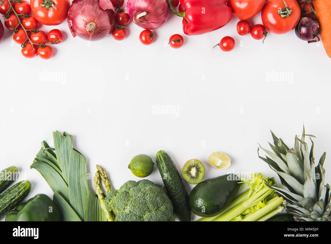 Border of green and red vegetables and fruits isolated on white background Stock Photo