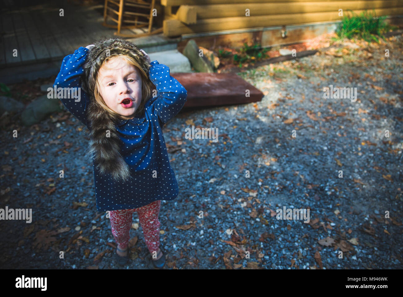 Girl with coonskin cap on - Stock Image